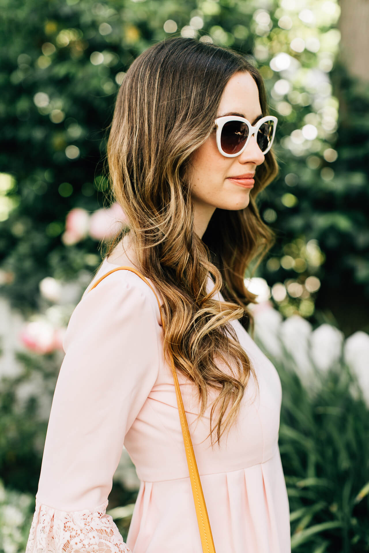 pink dress with white sunglasses