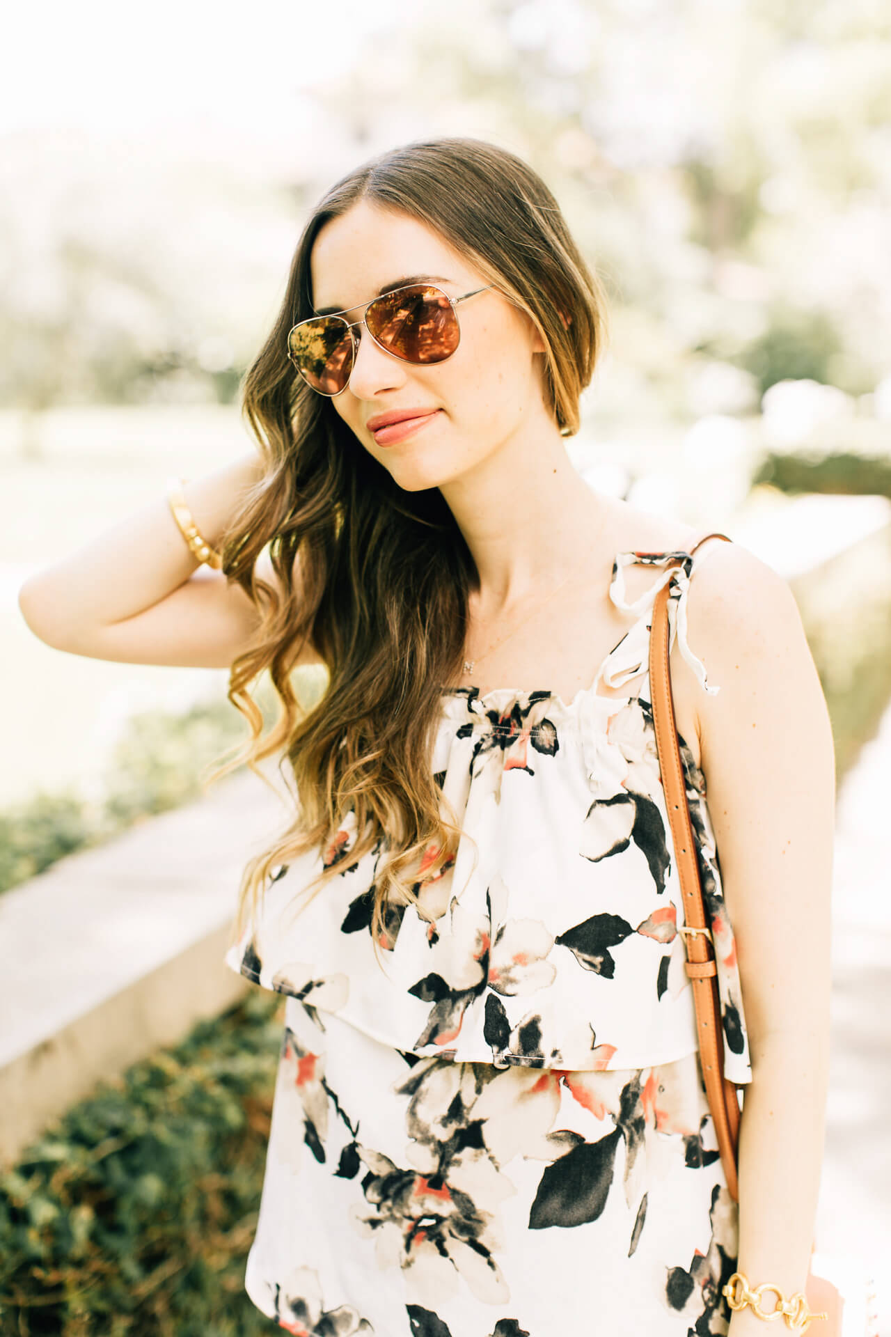 floral ruffled blouse with pink aviator sunglasses