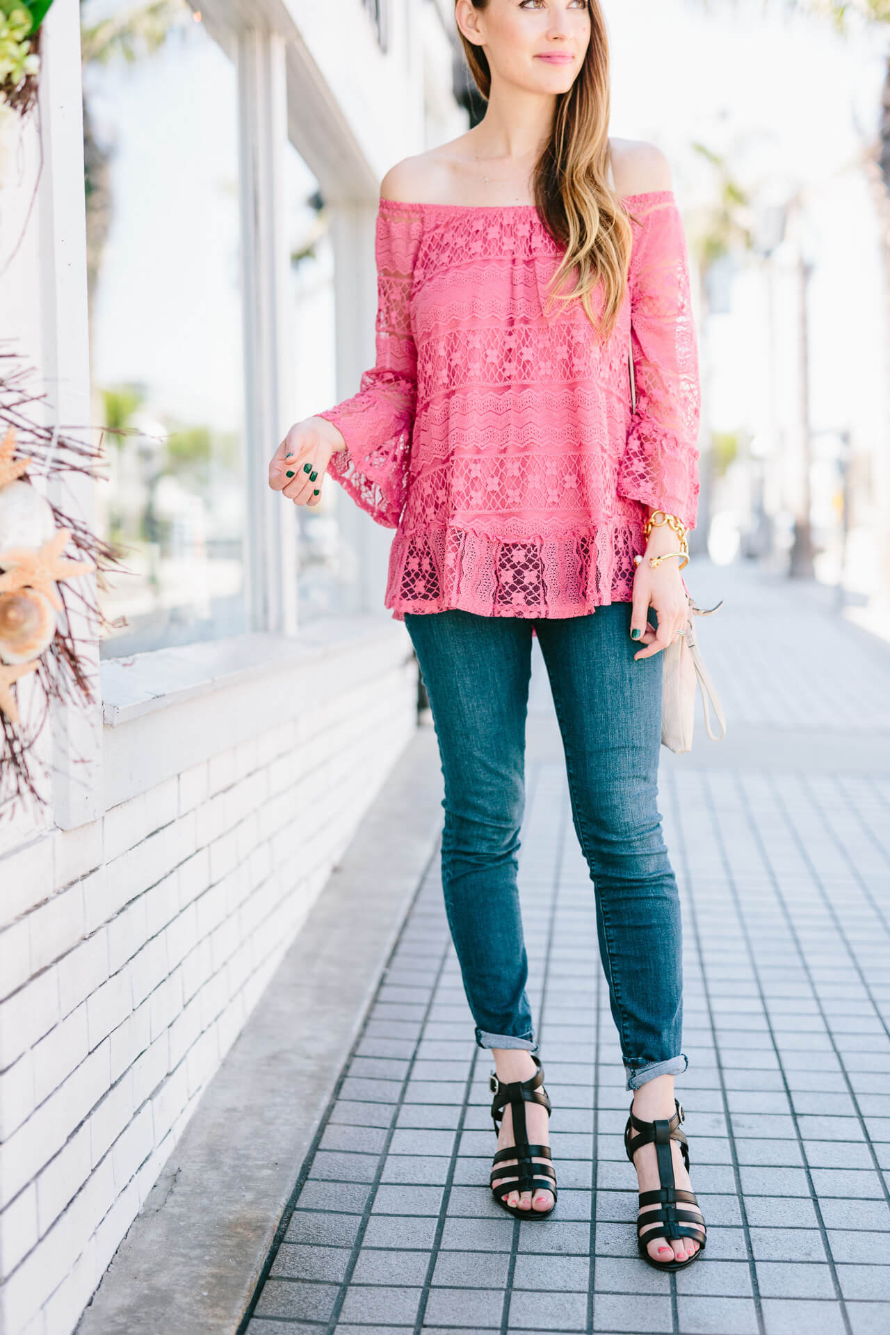 lace top styled with jeans and sandal heels