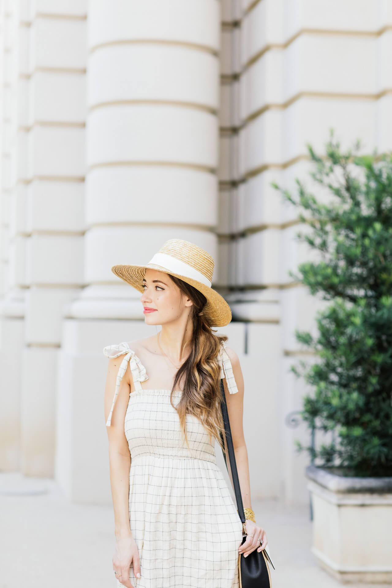 Stylish brunette highlights and straw hat inspiration