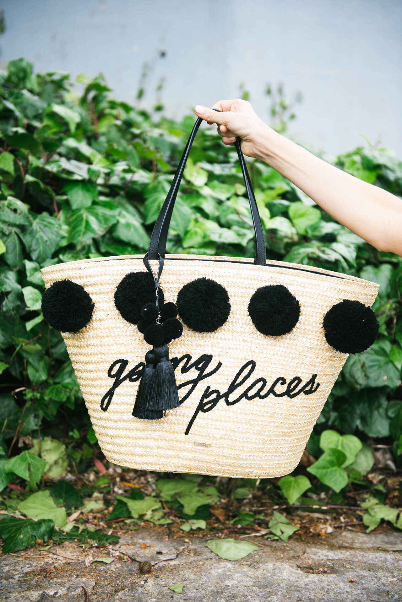 the bag of summer- kate spade going place straw tote with poms and tassels