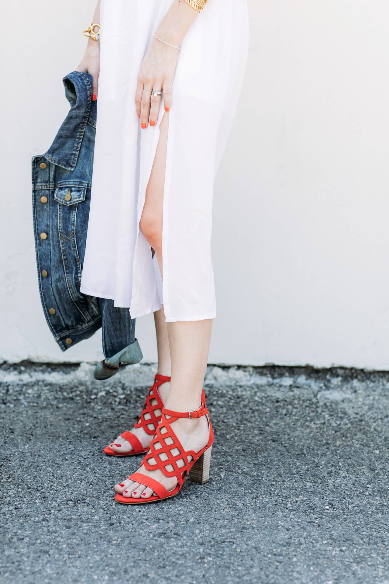 Styling red heels with a white dress and cute denim jackt