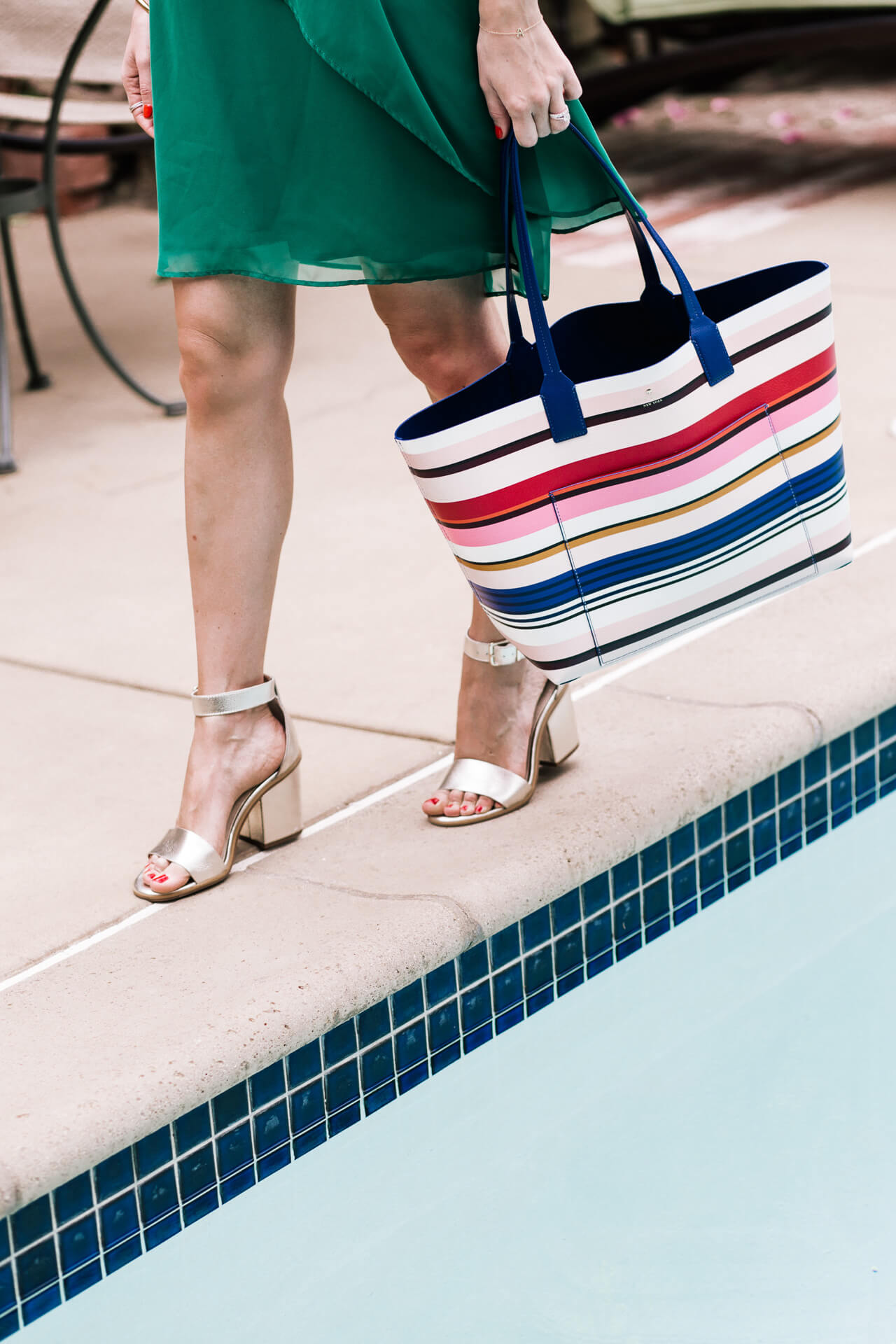 metallic shoes and striped bag pair perfectly
