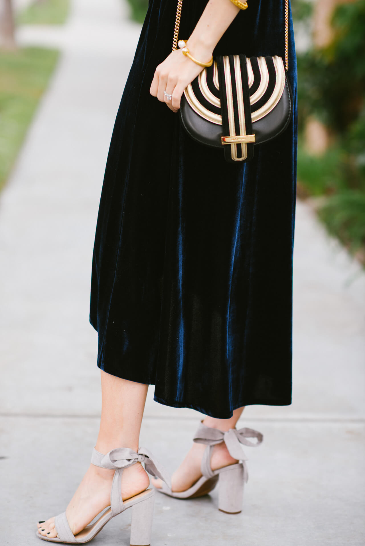 love this gold detailed crossbody with this velvet dress