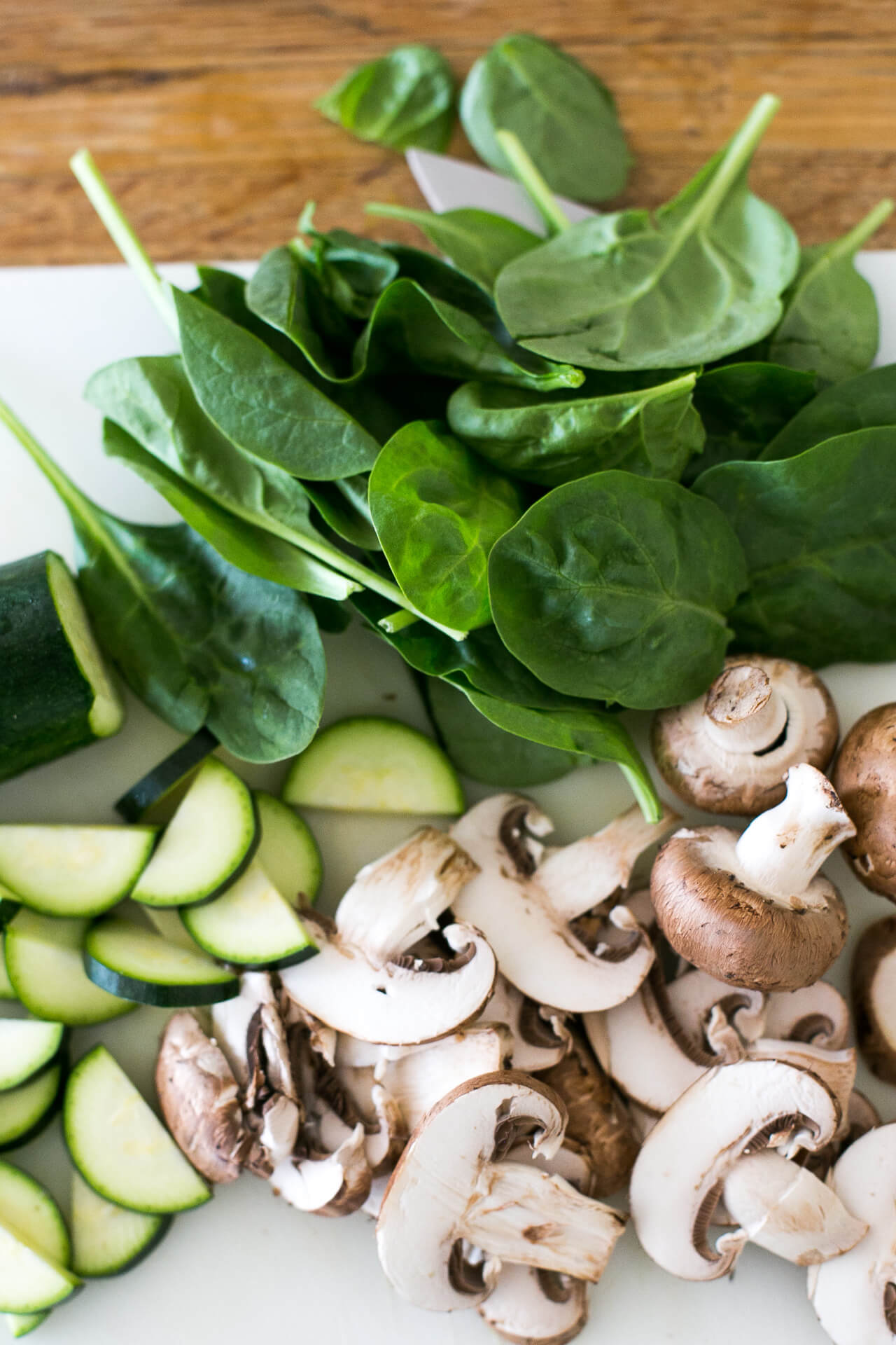 prepping my grain bowl with chopped zucchini, mushroom and spinach