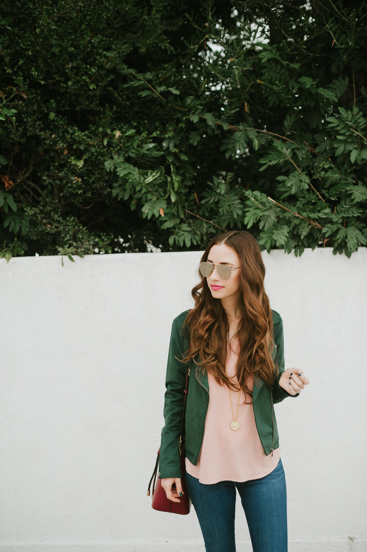 Los Angeles and Orange County Fashion Blogger M Loves M in green suede moto jacket and pink bell sleeve top
