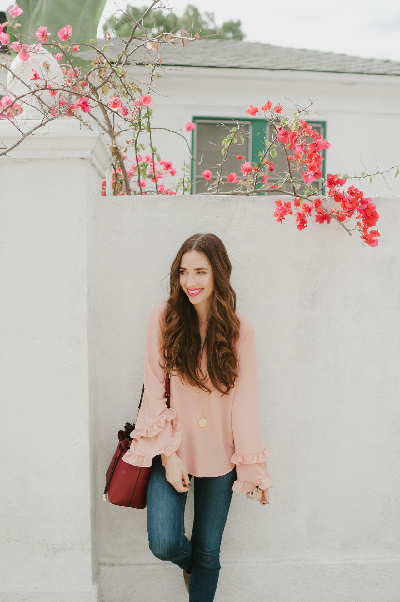 this pink bell sleeve top with the ruffles is so gorgeous!