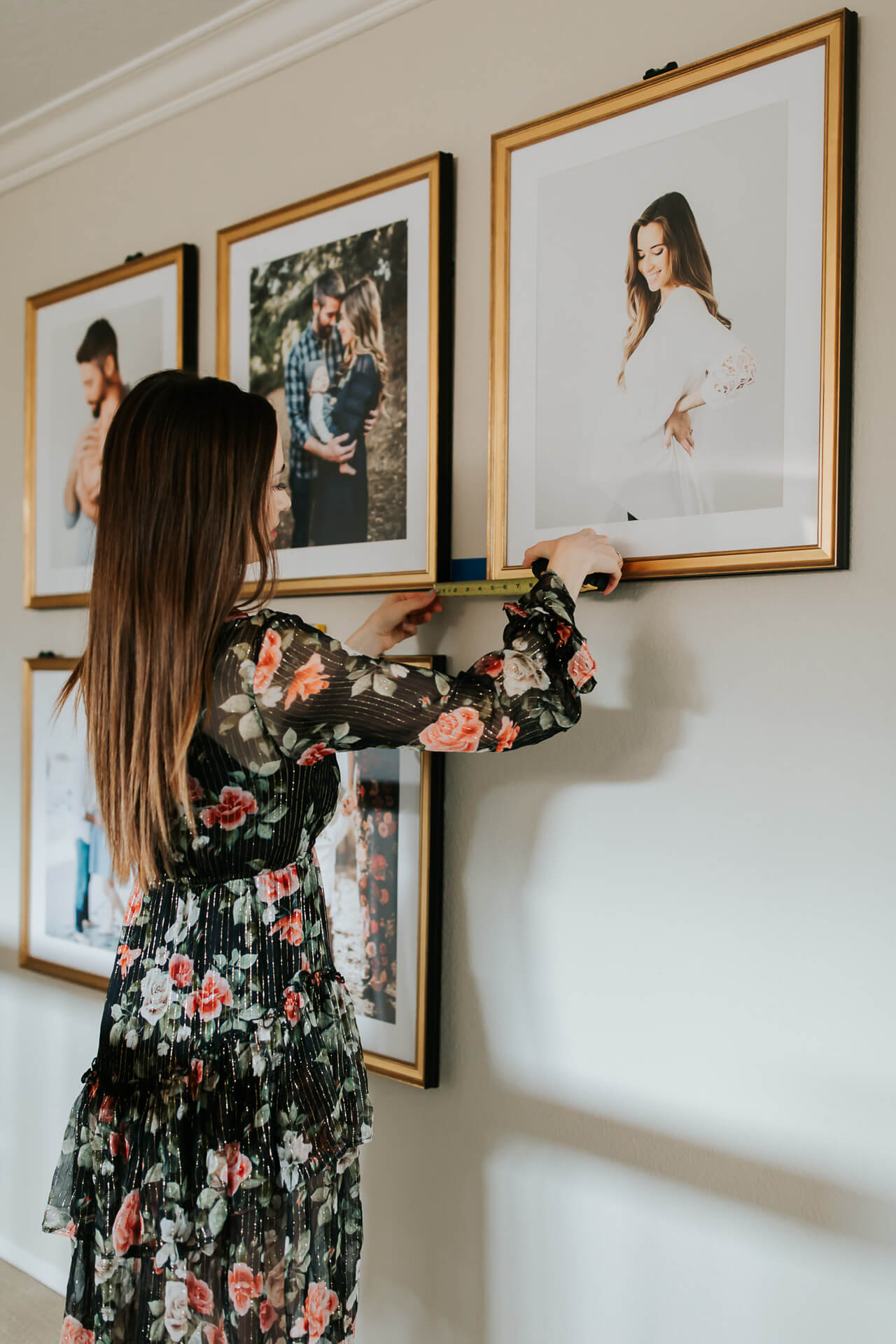 adding the finishing touches to our gallery wall