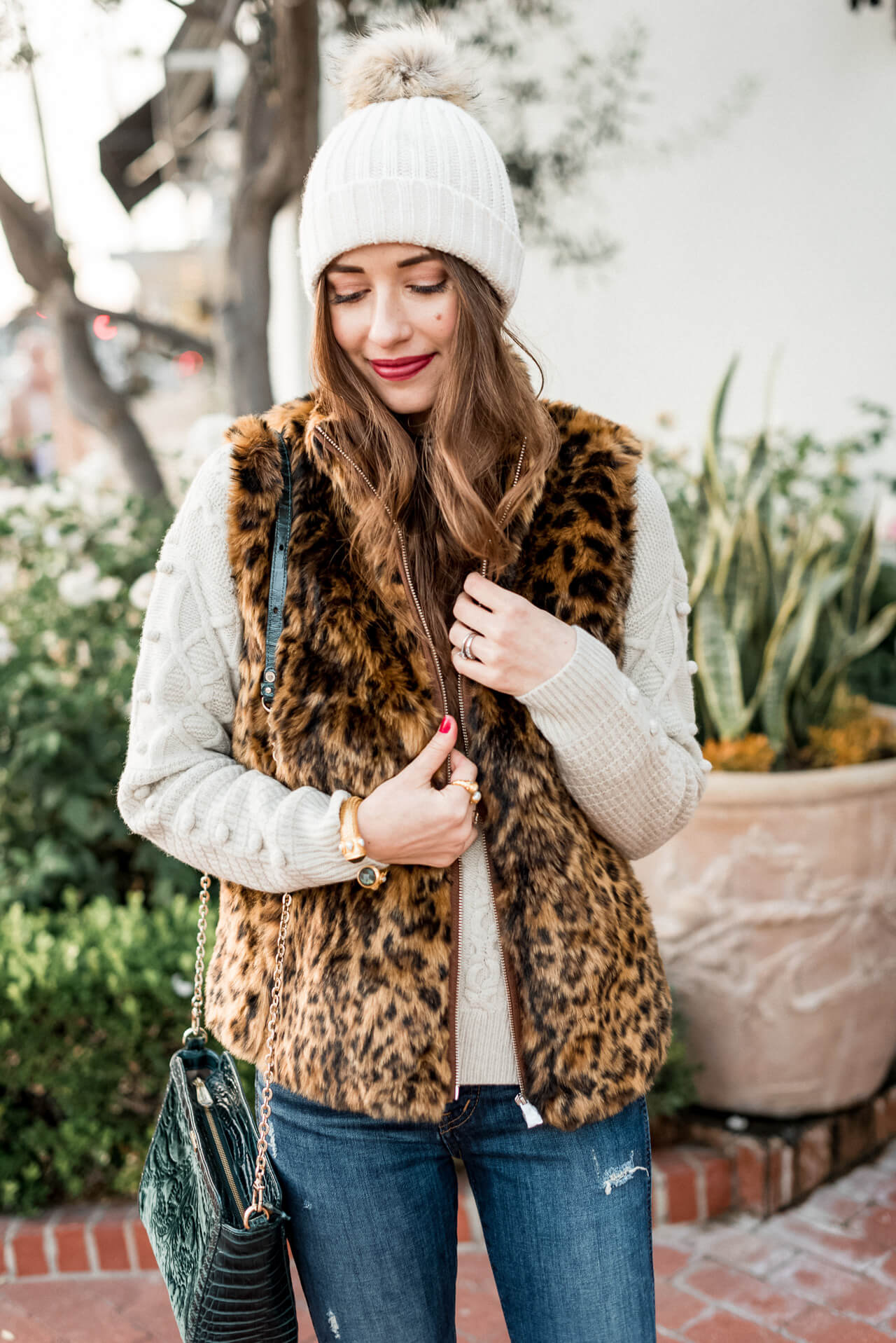 love this leopard vest to layer over sweaters