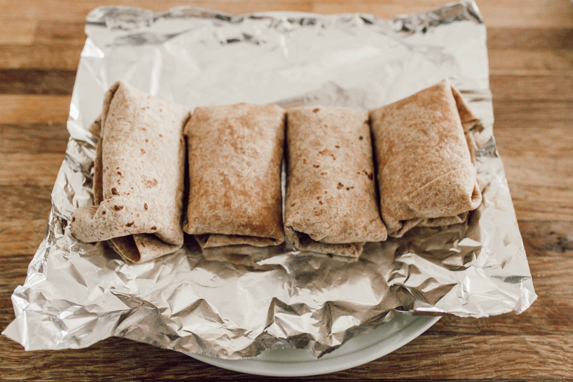 healthy breakfast burritos ready to be frozen for the week