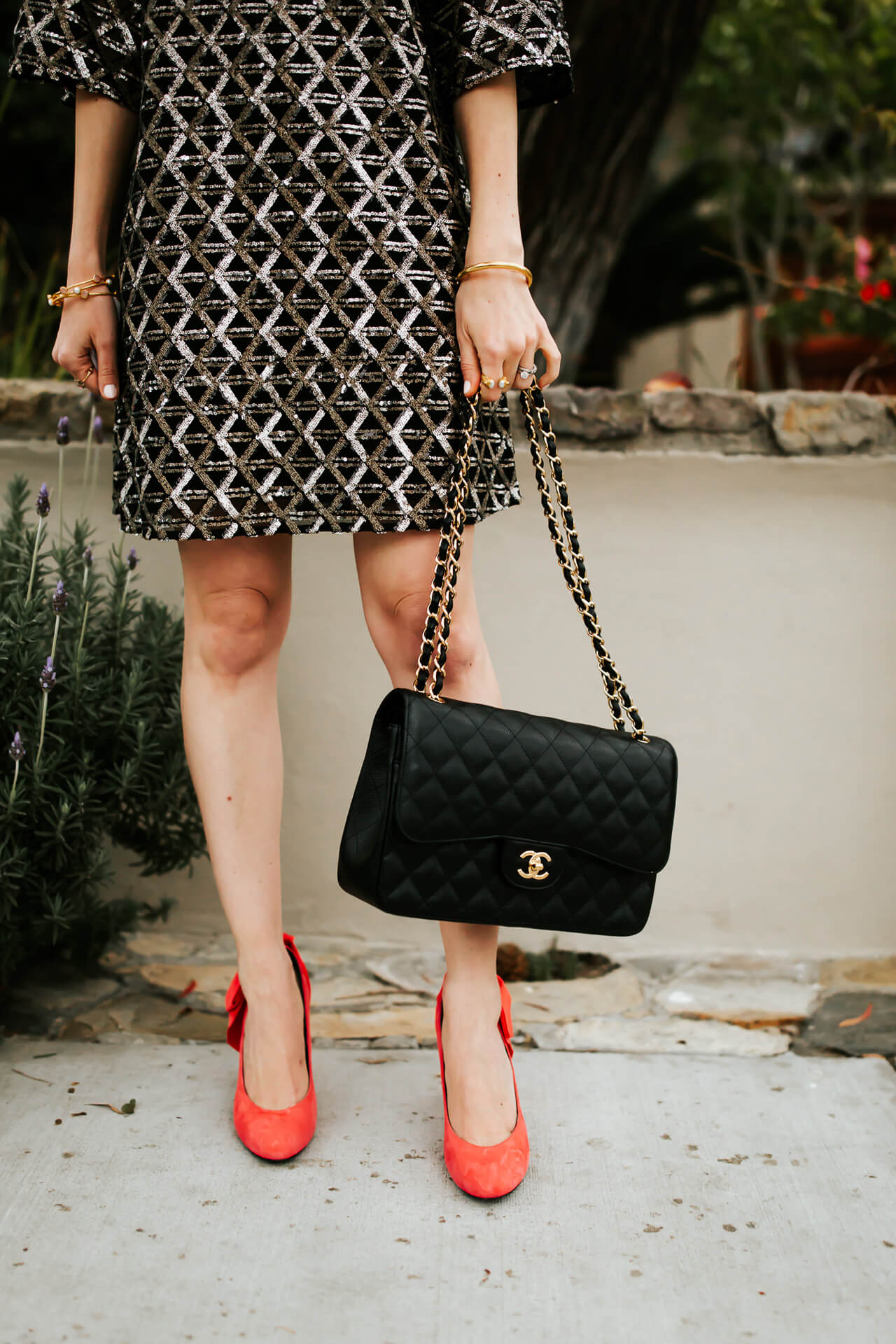 one of my favorite bags is this black Chanel one with a chain strap - M Loves M @marmar