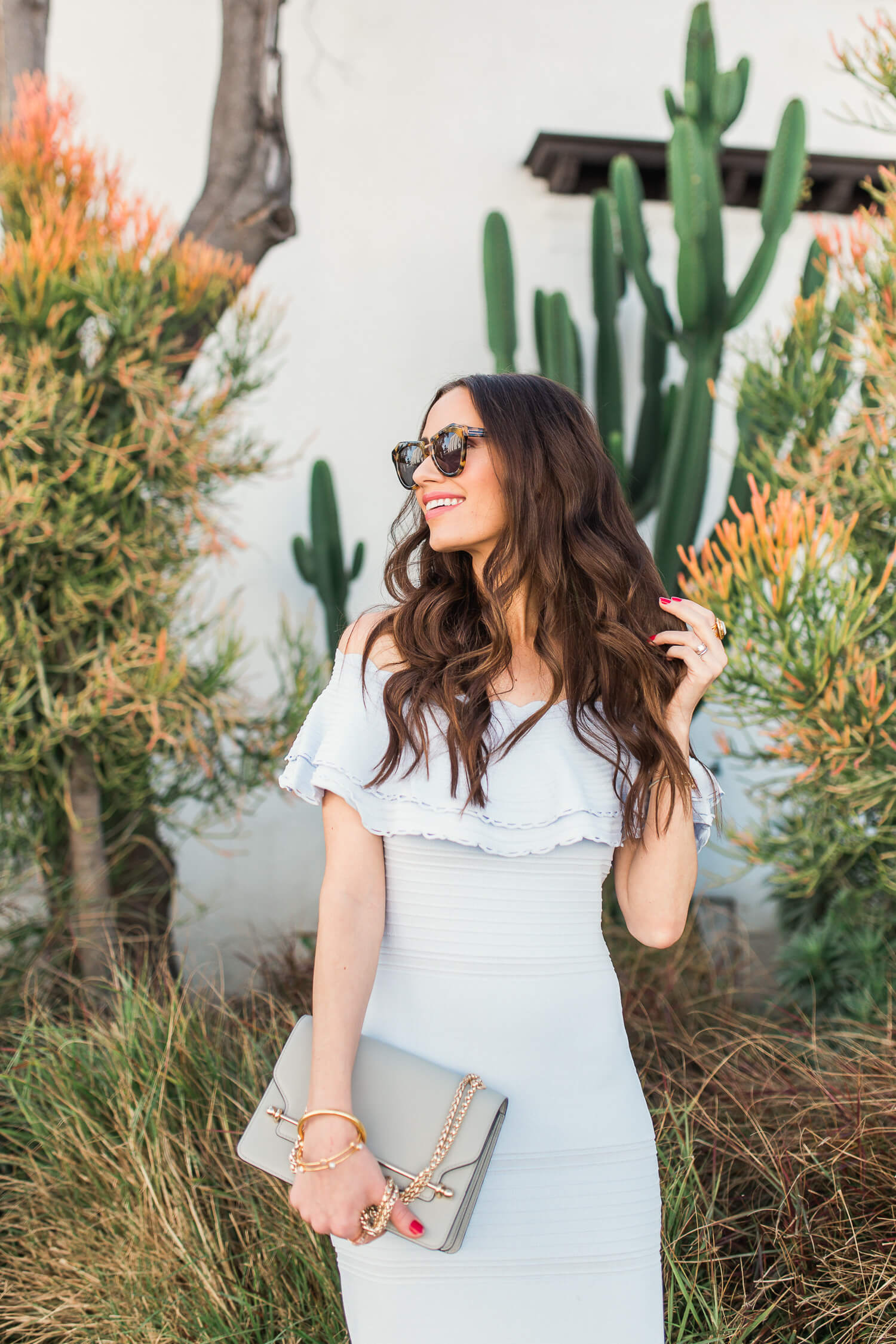 a neutral light blue dress from eliza J for spring with strathberry east west bag