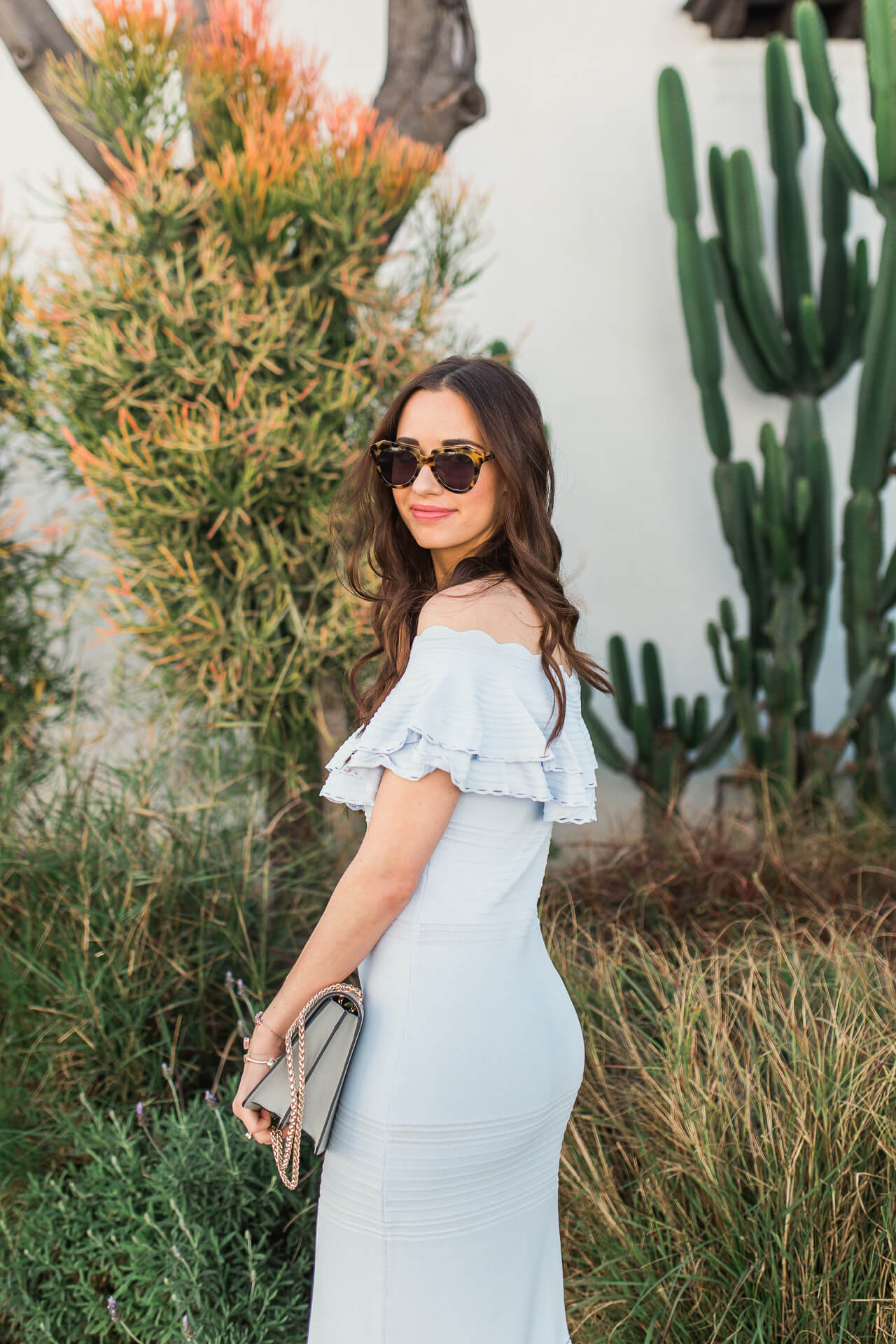 what to wear to a spring event - classic and timeless light blue ruffled off the shoulder dress
