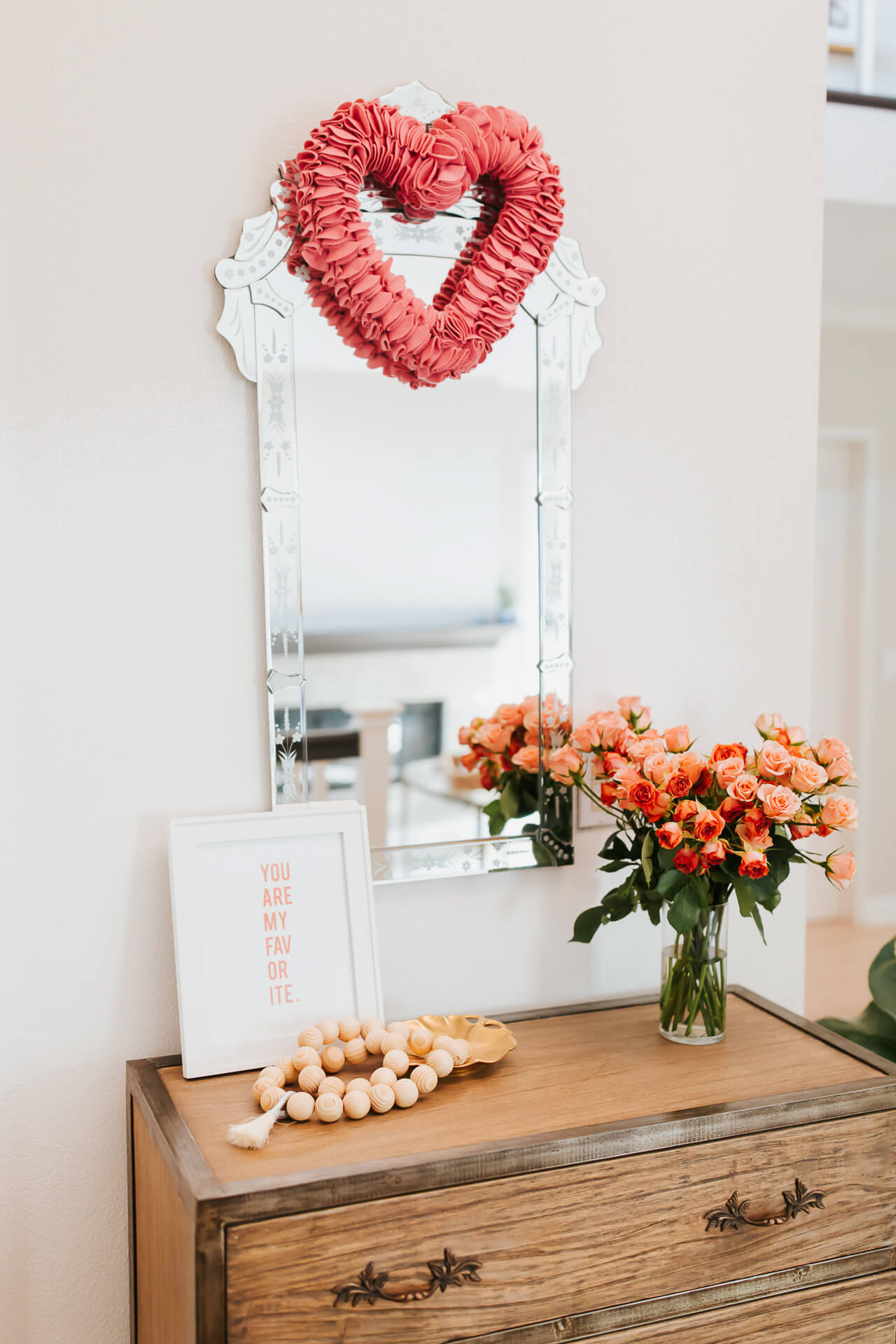 decorating the entryway for Valentine's Day