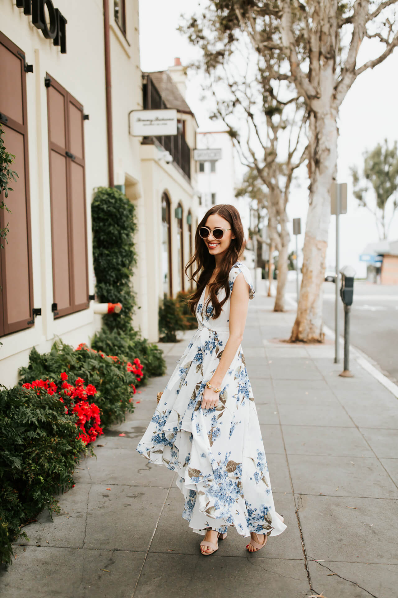 twirling in a lovely blue and white floral maxi dress