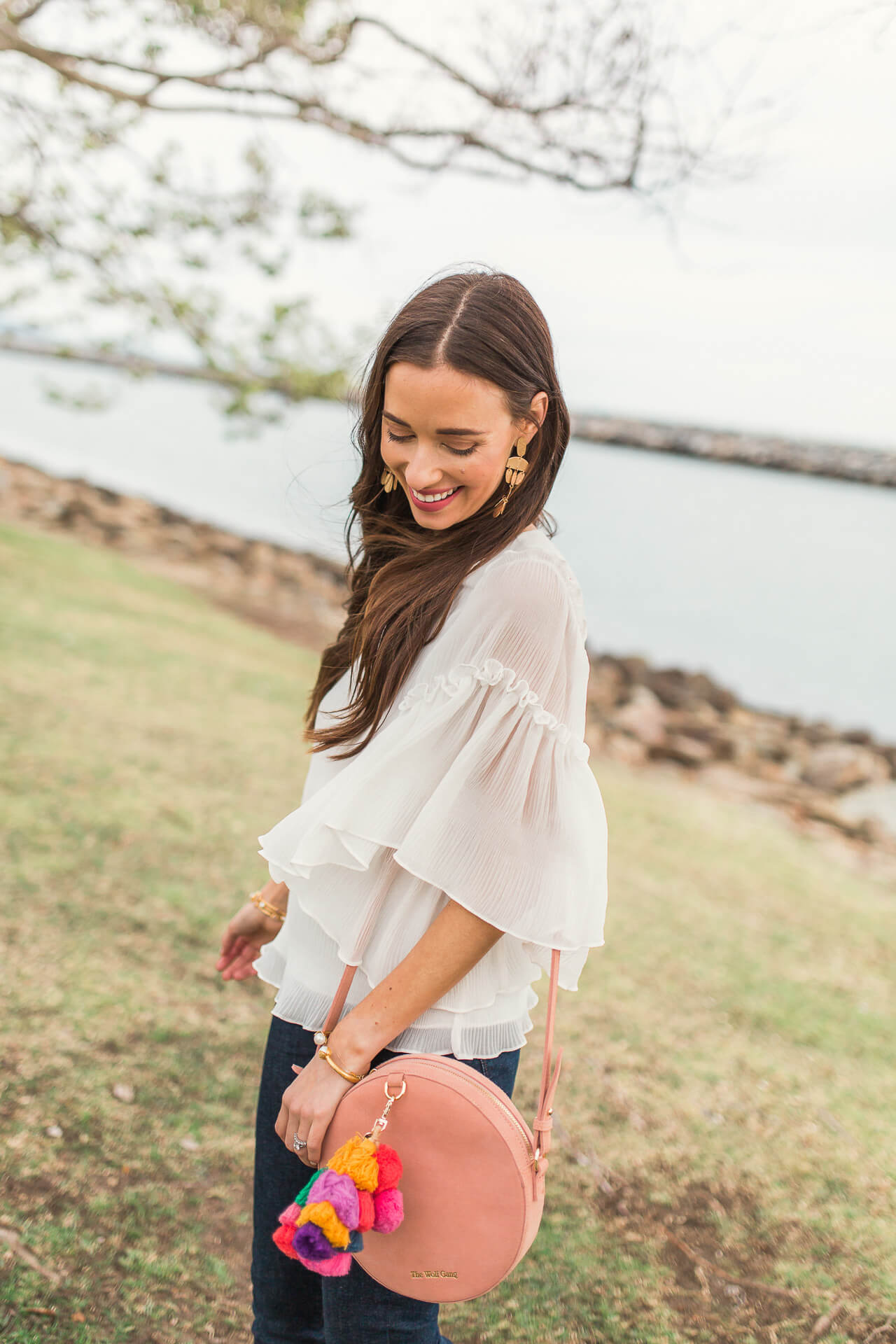 love this flowy white ruffled blouse for spring