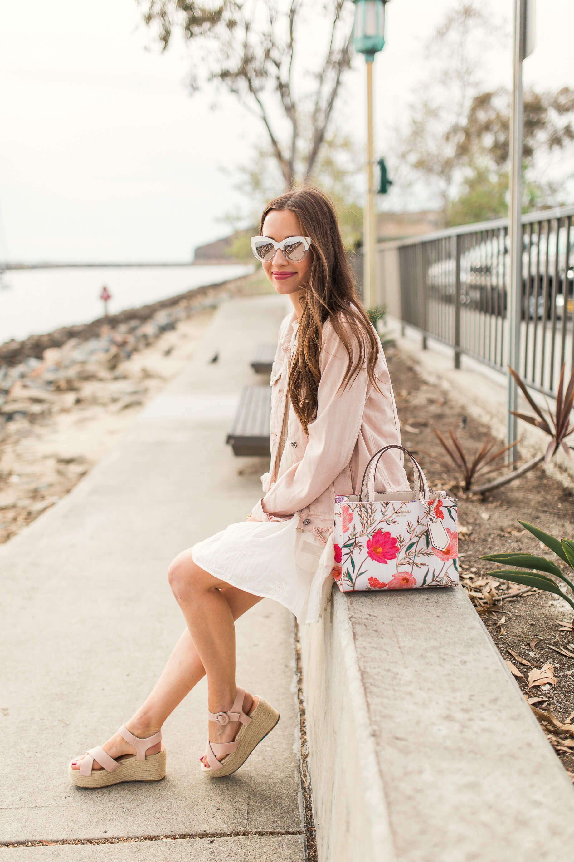 blush pink denim jacket and baby doll dress for spring