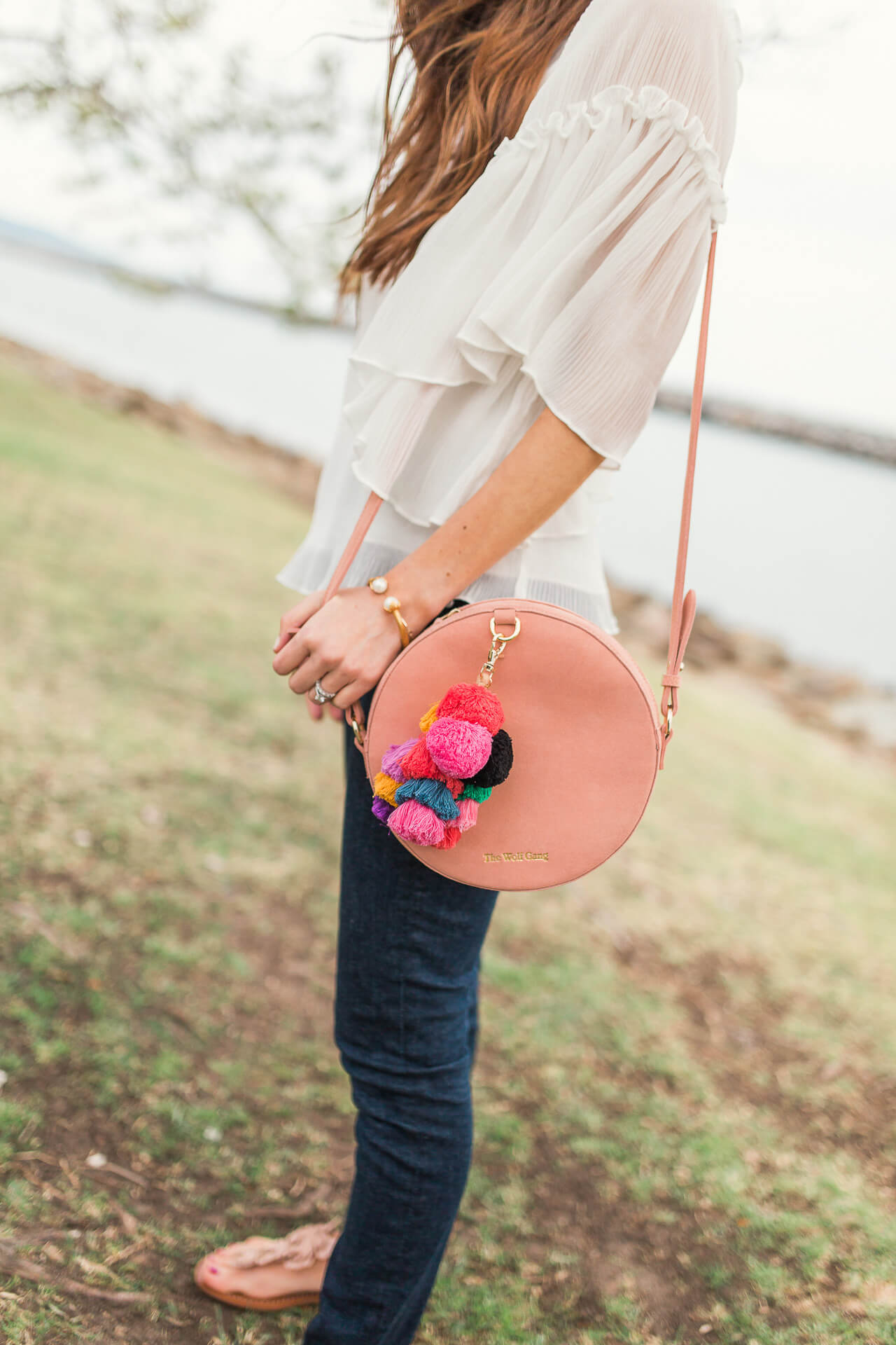 great pink circle bag with tassels