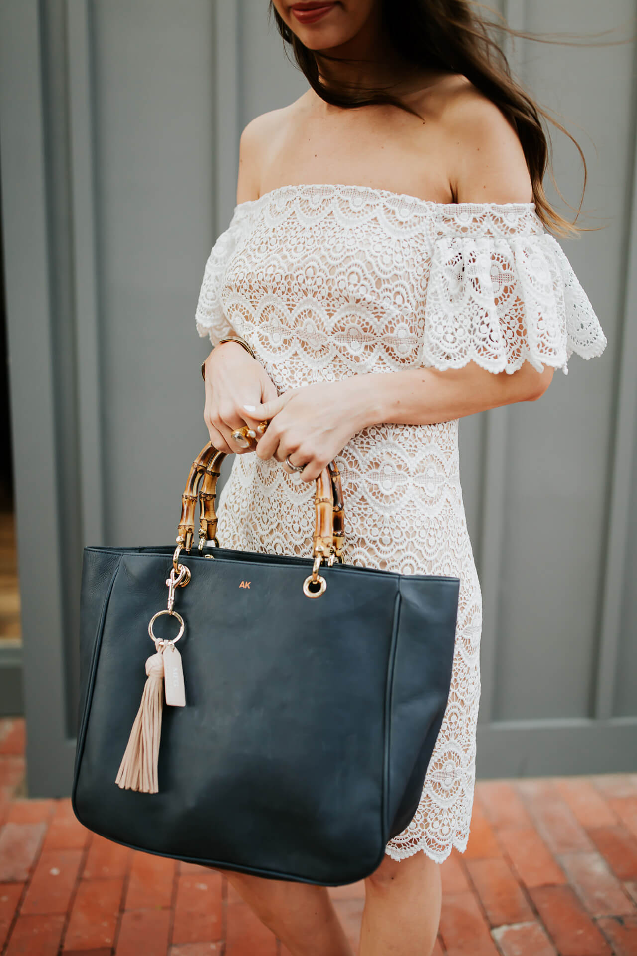mark and graham leather tote bag with pink tassel - monogrammed pieces are the best!