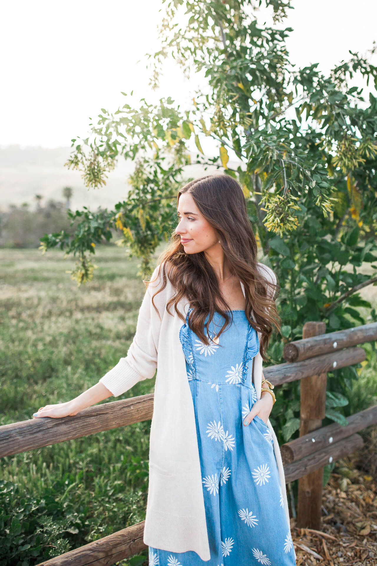 spring outfit inspiration with a jumpsuit and long cardigan sweater