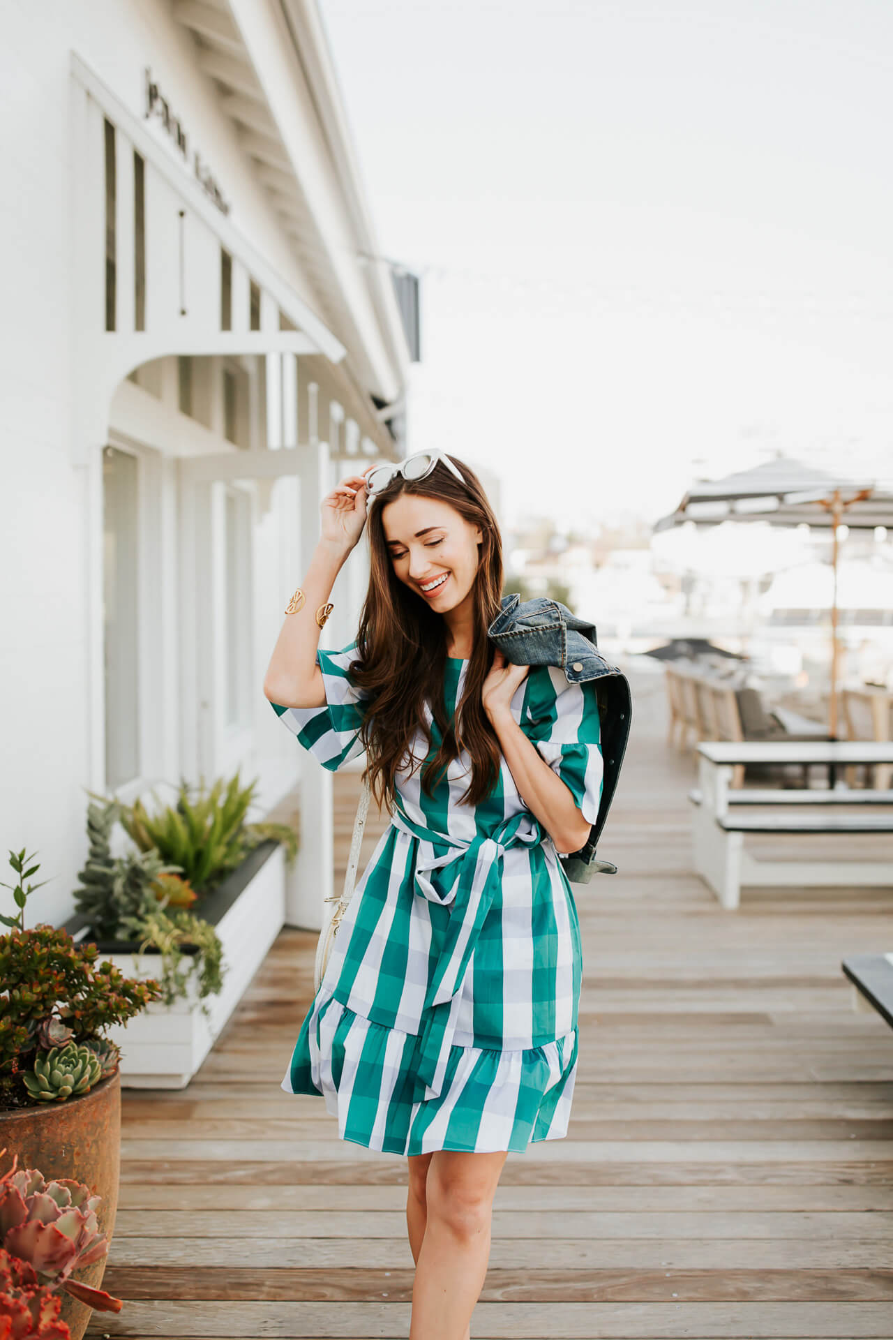 I really like pairing this sweet gingham dress with a denim jacket that adds a little edge. | M Loves M @marmar