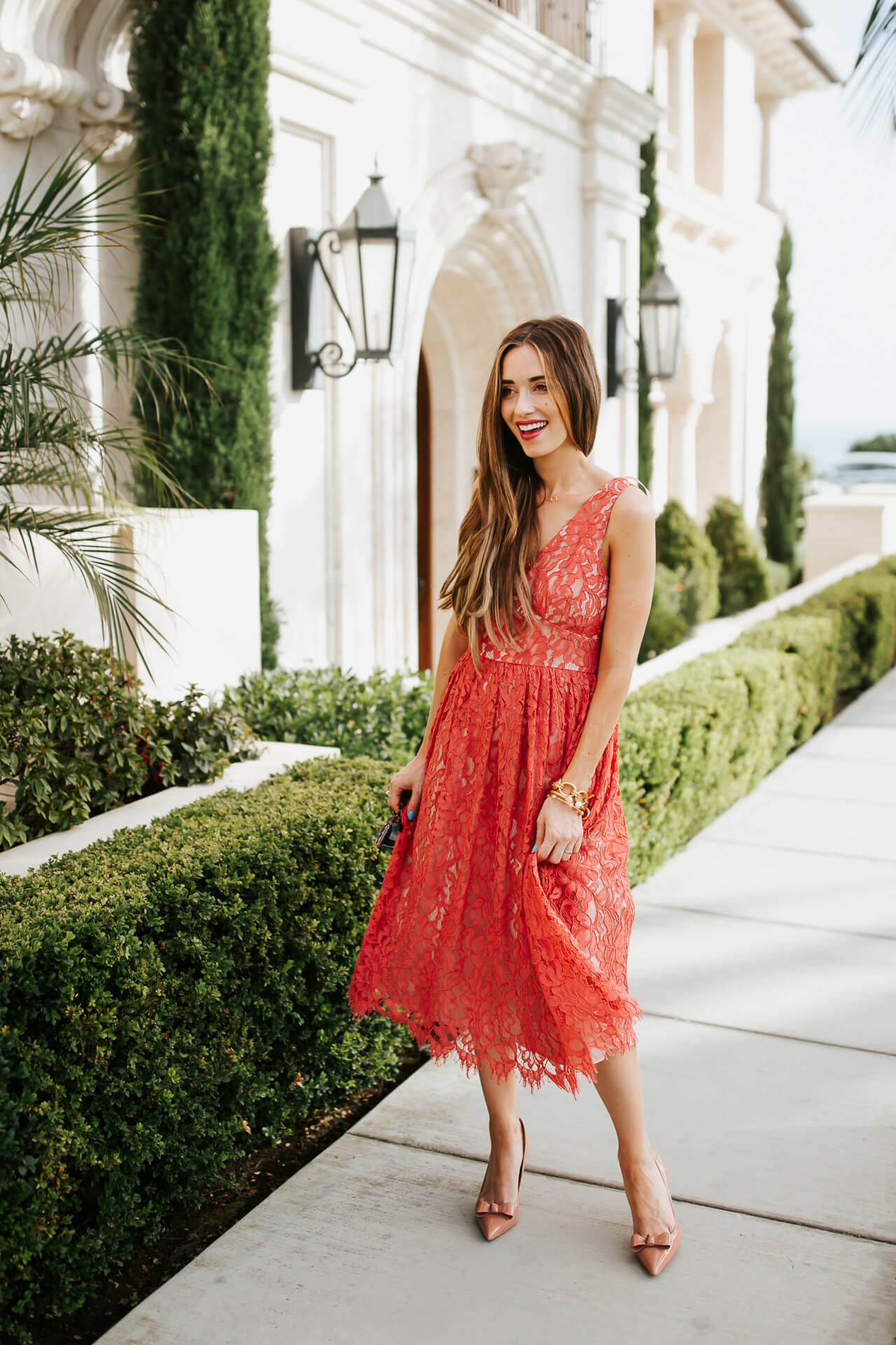 The prettiest red lace dress that is the perfect wedding outfit inspiration. | M Loves M @marmar