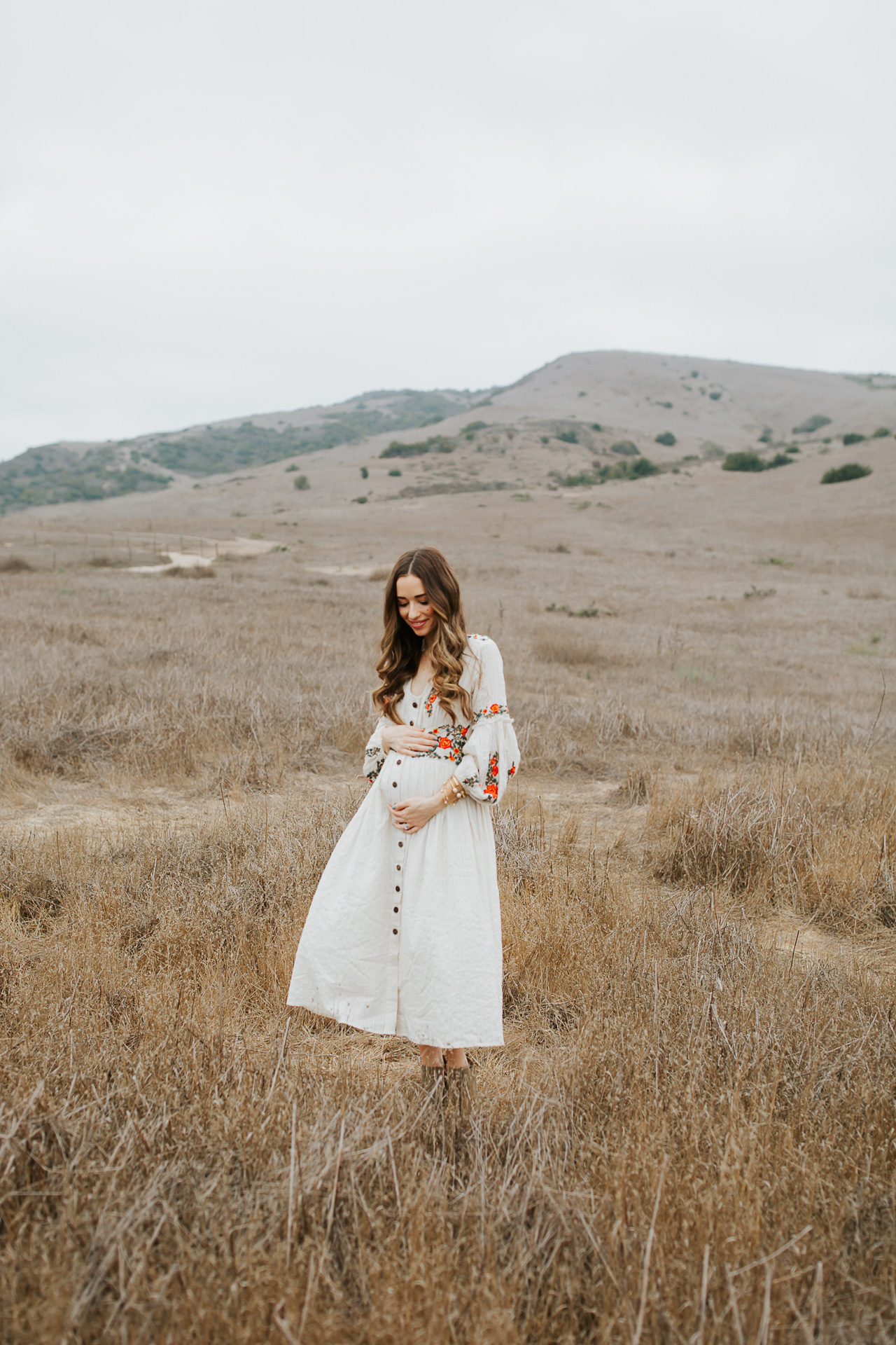 A white maternity dress from Anthropologie. | M Loves M @marmar