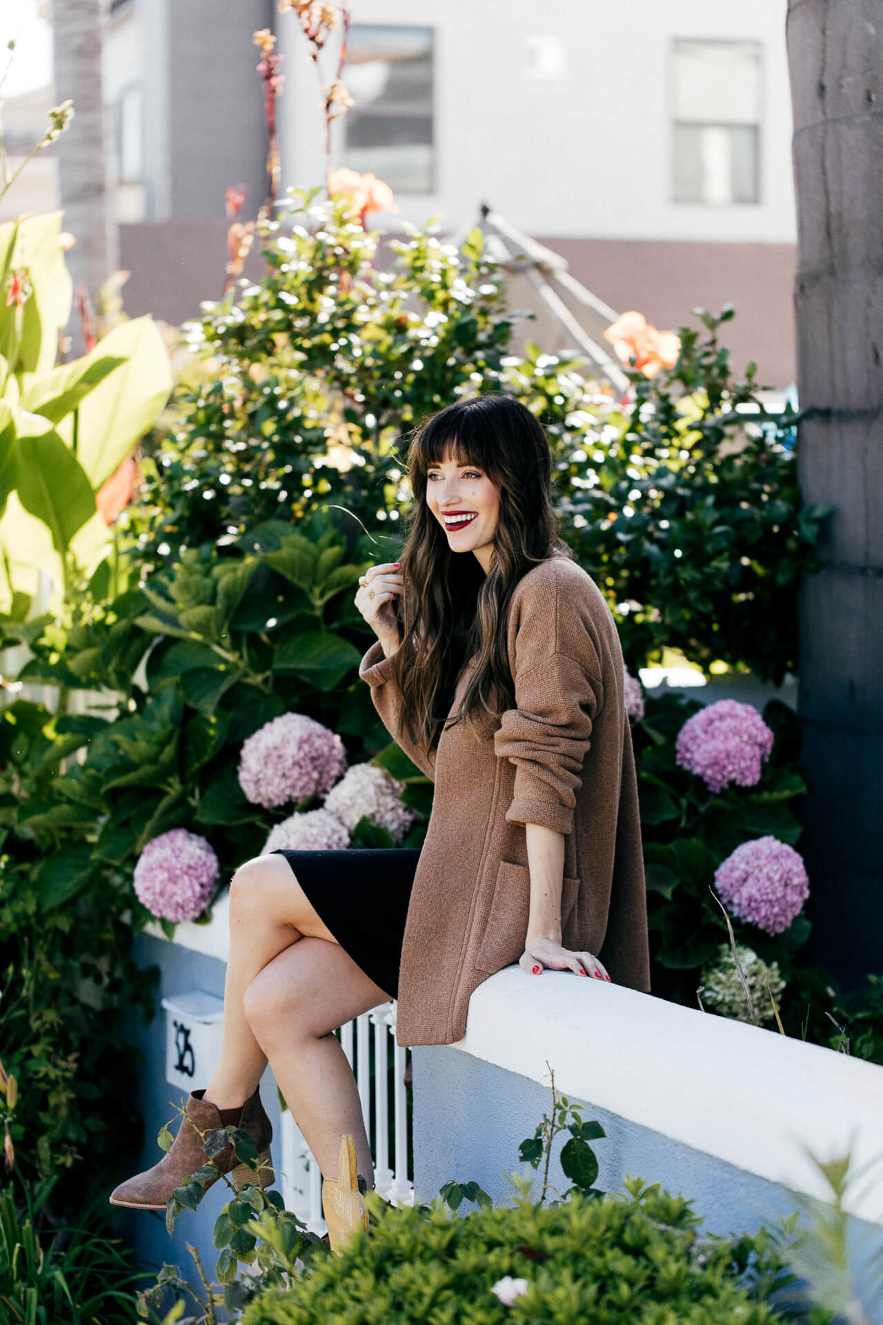 This black dress and camel sweater is a perfect combo. | M Loves M @marmar
