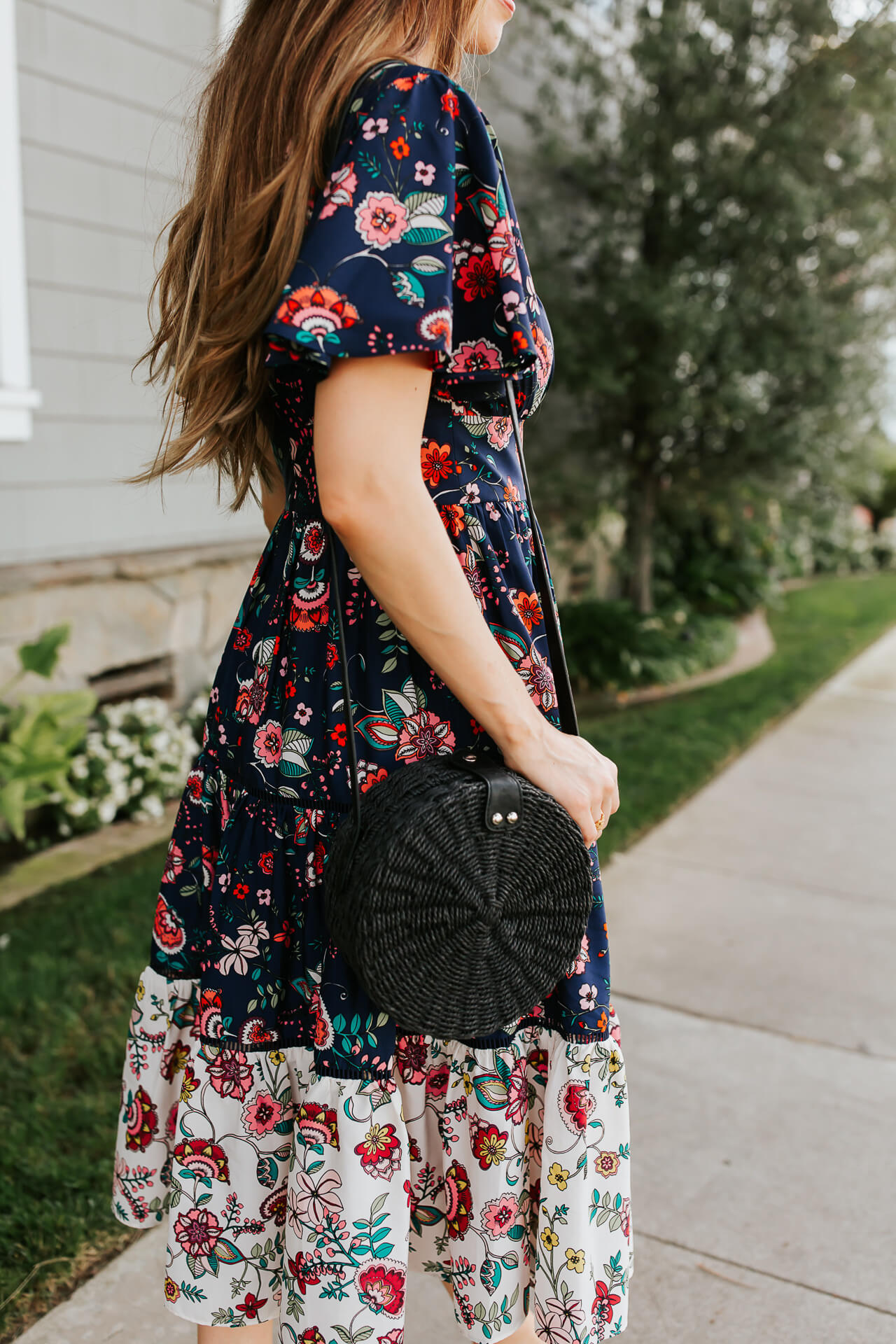 Blue floral wrap dress and black circle straw bag. | M Loves M @marmar