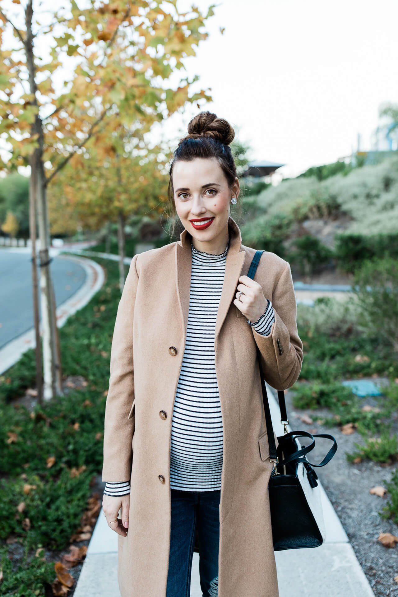 This camel coat and striped shirt combo is French girl inspired! - M Loves M @marmar