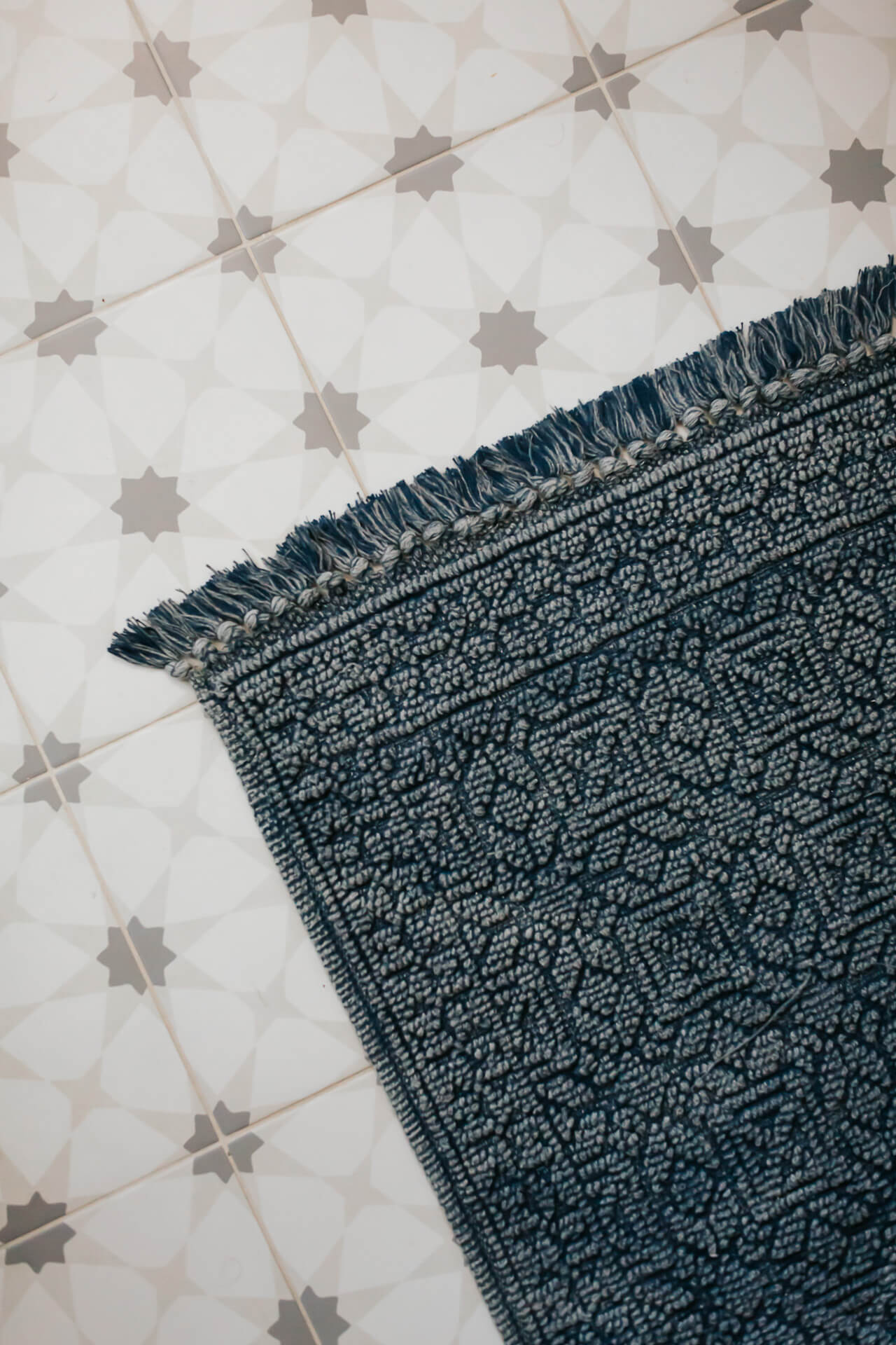 A pretty blue rug with a white printed tile. - M Loves M @marmar