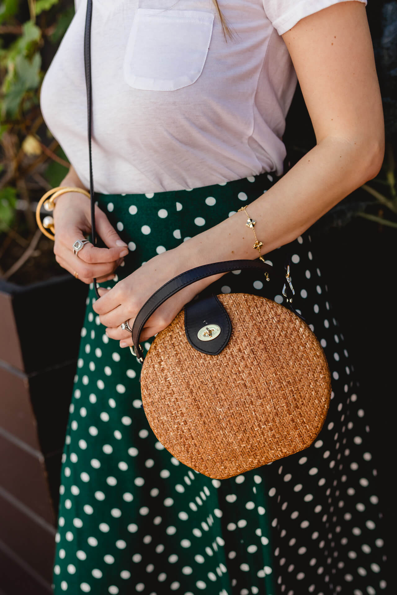 A fun straw bag with a black strap for summer! - M Loves M