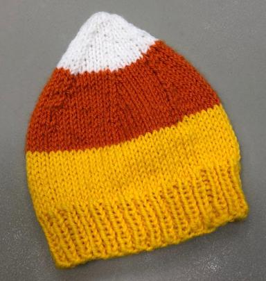 dfdd63791d3 Candy Corn Hat – a FREE Pattern to knit in Encore Worsted. More seasonal  ideas coming soon. This is a fun time of year for knit   crochet!