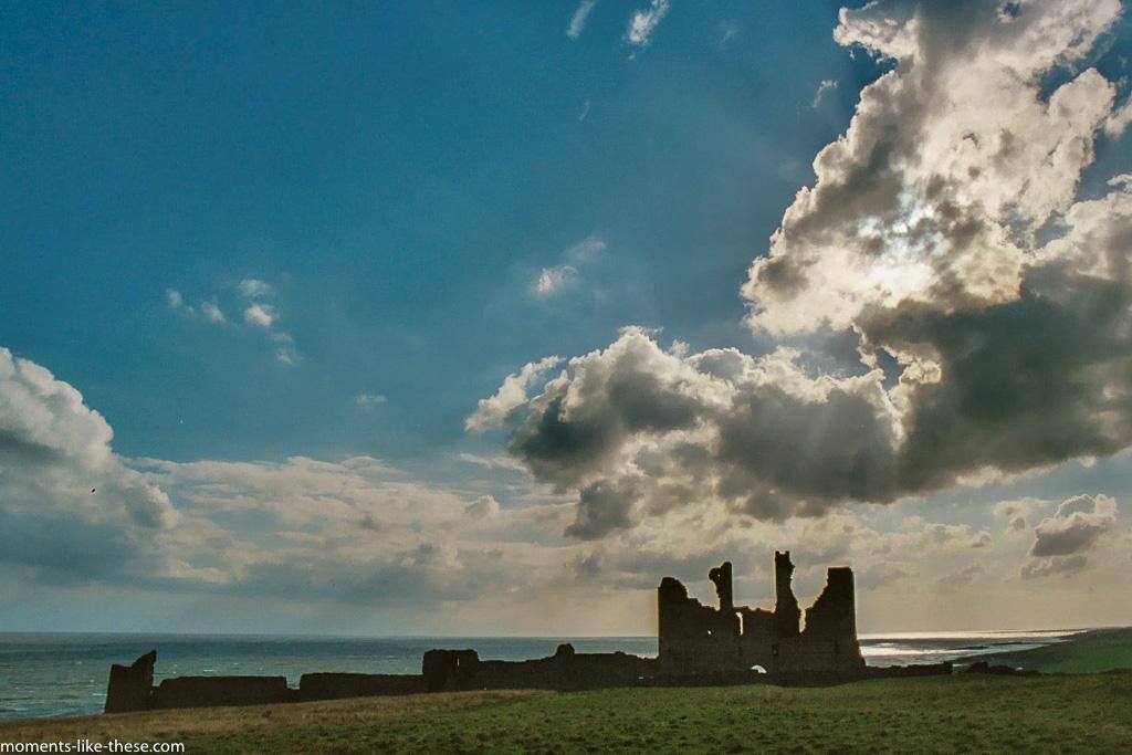 Dunstanburgh Castle under clouds