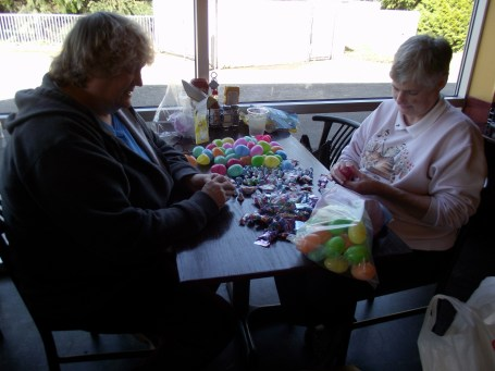 Ann Nygaard (on left) and Jolene Evans filling plastic Easter Eggs to be used in two egg hunts in Mountlake Terrace.