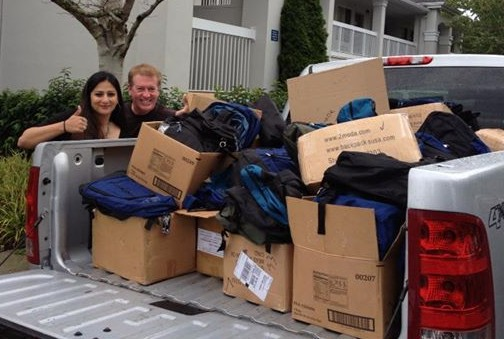 Mountlake Terrace Business Association President Ayesha Sheikh (on left) and Mountlake Terrace City Council member and restaurant owner Seaun Richards prepare to deliver new backpacks to two MLT elementary schools