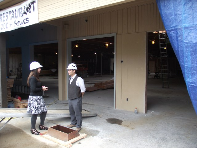 Sherry Jennings, Diamond Knot Craft Brewing Director of Communication (left) talks to LLC West Plaza representative Kirk Ishizaki in front of the brewpub's north exterior wall, which will include openings with garage doors that will allow for easy access to outdoor seating at the brewpub