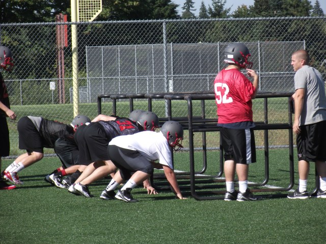 The first practice was without pads as coaches put the team through various drills