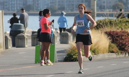 Mountlake Terrace resident Kate Nishino placed second in the women's division of the Alki Beach 5K benefiting Northwest Hope and Healing, a nonprofit that helps breast-cancer patients. A former Edmonds-Woodway High School cross country standout, Nishino is now assistant cross country coach at EWHS and was running with several current members of the E-W cross country team. (Photo courtesy of the West Seattle Blog)