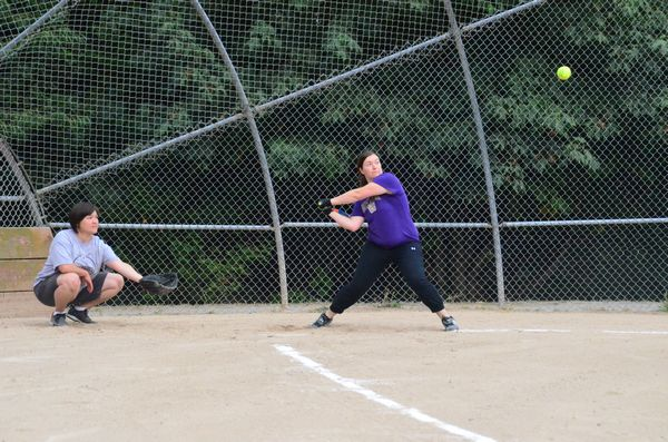 Becky Hill, MLT PD, goes for the fences.  Catcher is Tammy Rankins of Edmonds Parks and Rec.