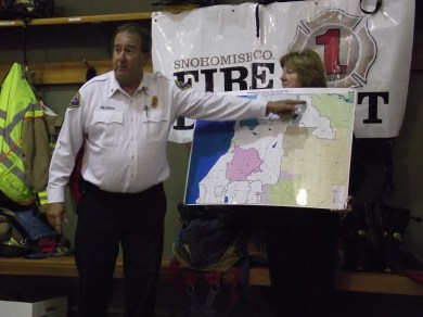 Fire District 1 Assistant Chief Brad Reading points out the area that the Fire District services in South Snohomish County; assisting him is the district's Fire and Life Safety Education Specialist Kim Schroeder.
