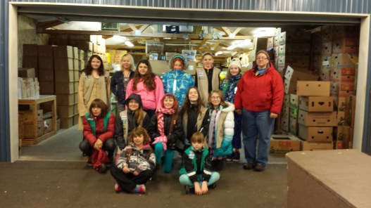 The Girl Scout troop at the Concern for Neighbors Food Bank.