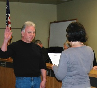 Jim McGaughey is sworn in as a district fire commissioner.