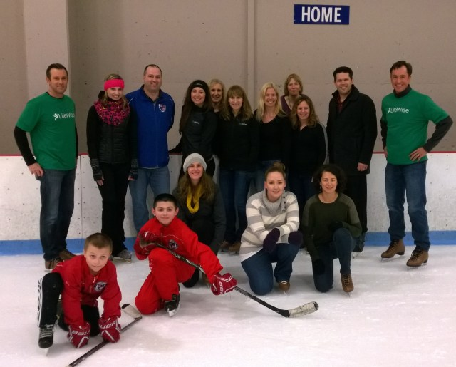 Arian Kukors, in the black headband, with Premera employees at Olympic View Ice Arena Wednesday.  The children in the photo are the sons of Kory Berg, a Premera/LifeWise employee.