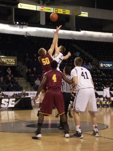Central Catholic's Blake Brandel and Terrace's Greg Bowman go after the opening tip.