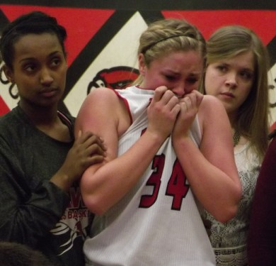 Maddy Kristjanson is visibly upset after fouling out of the game with 3:30 remaining. (Photo by Doug Petrowski)