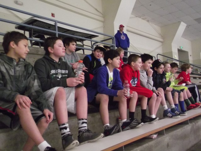 A Seattle Junior Hockey Association Peewee division team (11- and 12-year-olds) waiting for their chance to get on the ice for practice. (Photo by Doug Petrowski)