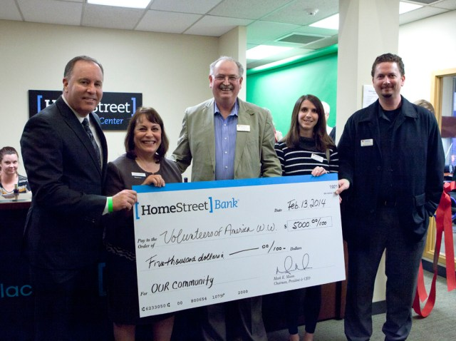 From left, HomeStreet Bank President and CEO Mark Mason and VP and Retail Manager of the MLT Office Marilla Sargent present a check to Volunteers of America, Western Washington, from left CEO Phil Smith, Leanne Gieger of Direct Services and VP of Development Mark Johnson.