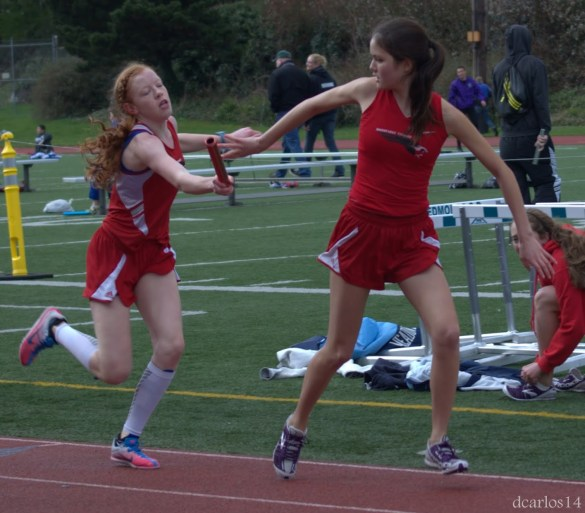 Mountlake Terrace High School's Ella Schroth passes the baton to Rebecca Oylear. (Photos by David Carlos)