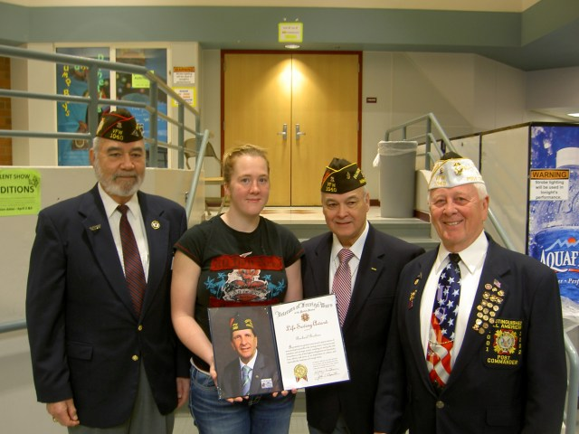 Leadership from VFW Post 1040 presented MTHS basketball coach Rachael Moehme (second from left) with the VFW National Life Saving award recently. Pictured left to right: VFW Post 1040 Senior Vice CommanderFrank Martinez, Boehme, VFW Post 1040 Chaplin John Zambrano, VFW Post 1040 Commander Martin Spani.